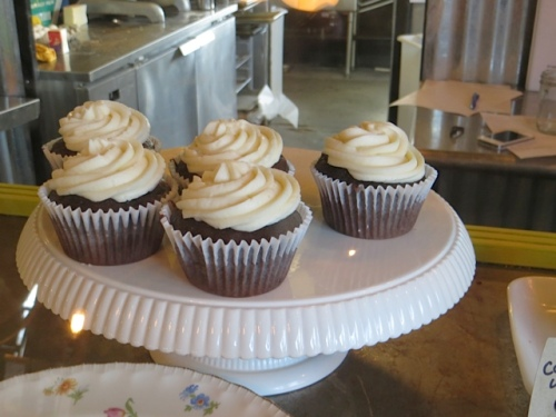 and two chocolate cupcakes with vanilla buttercream frosting.