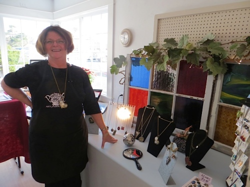 Debbie by her jewelry display