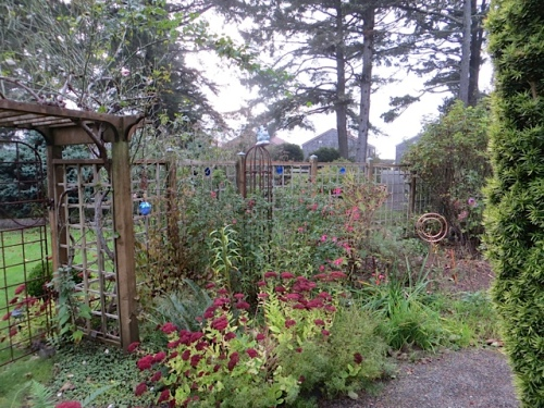garden with cottages in the background