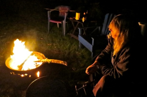 Poking at the fire is so relaxing.  (Allan's photo)