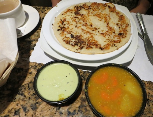 Kathleen's dinner, a potato-onion pancake sort of dish, whose name I do not know, with soup and a sauce.