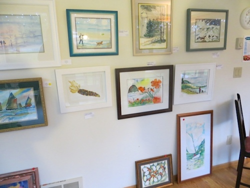 We loved the art and bought two prints and some cards and a mirror framed in beach glass.