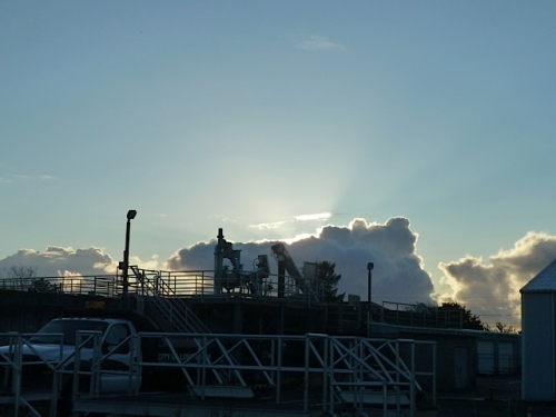 the clouds over the sewer plant as we dumped debris at city works