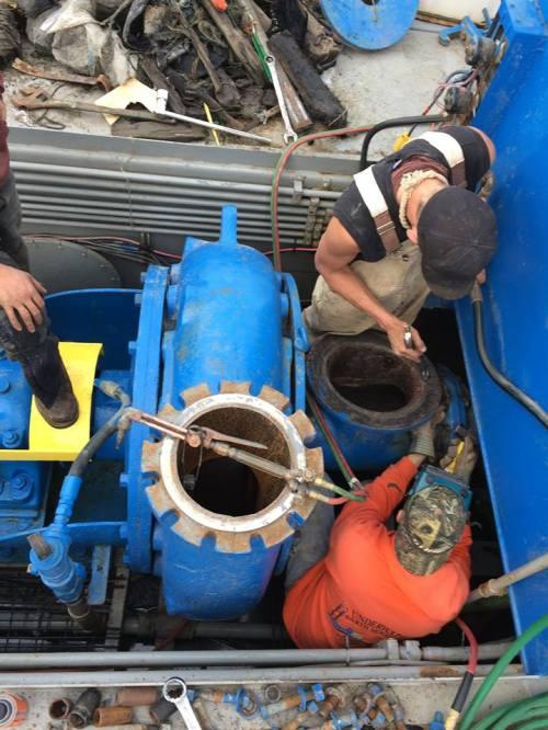 dredge repairs, photo by Nancy Beesley