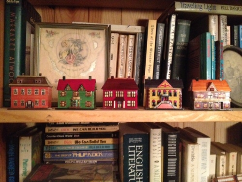 I could not resist five little houses for $2 each.  Here they are on my bookshelf a day later.