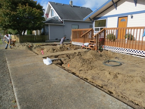 The crew laid in the pipes (after removing some old diseased lilacs and part of a fence).