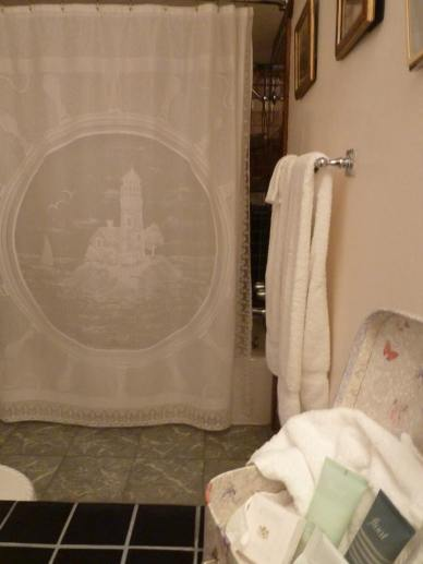 I love the lighthouse shower curtain in the Garden Suite bathroom.