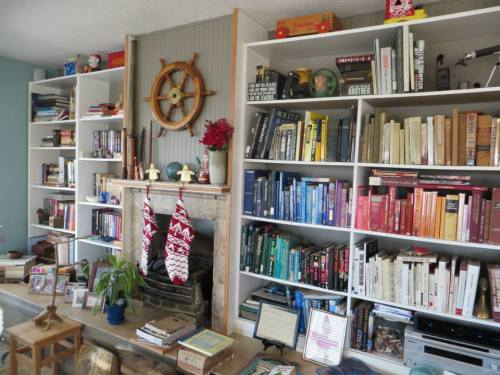 a wall of books, many of them mysteries.  (Of course, I had to recommend the Seaside Knitters series.)