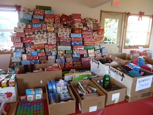 Shoeboxes are packed and wrapped with gifts for the elderly.