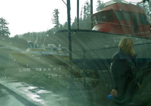pouring rain while trash picking in the boatyard garden (Allan's photo)