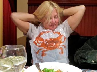 Marla donned the proffered bib for her prawn dish but turned out to not need it.