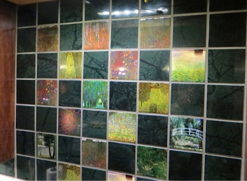 over the sink, tiles of paintings.
