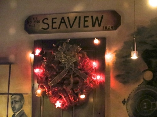 wreath hung on the original door to the train depot