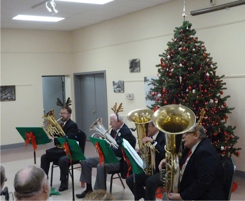 left to right: two euphoniums and an f tuba and a double b flat tuba