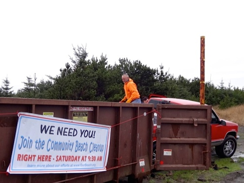(Allan's photo) A volunteer loads up the dumpster.