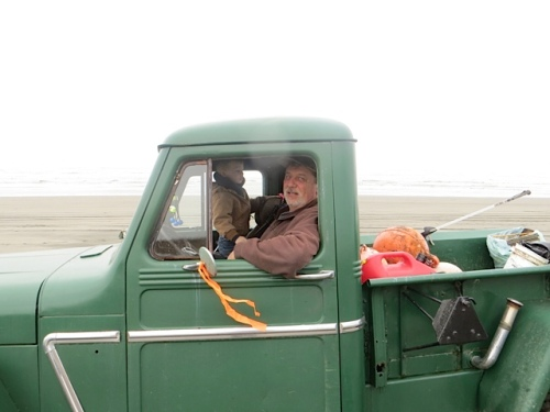 Volunteers in a cute old truck.