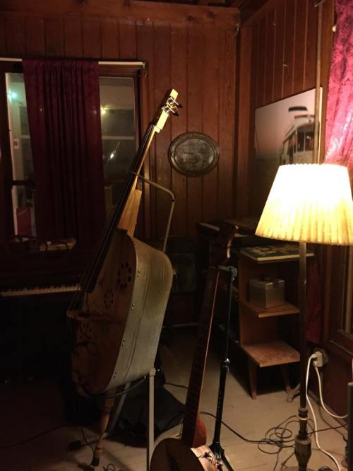 made from a washtub, plywood and, well, instrument parts.