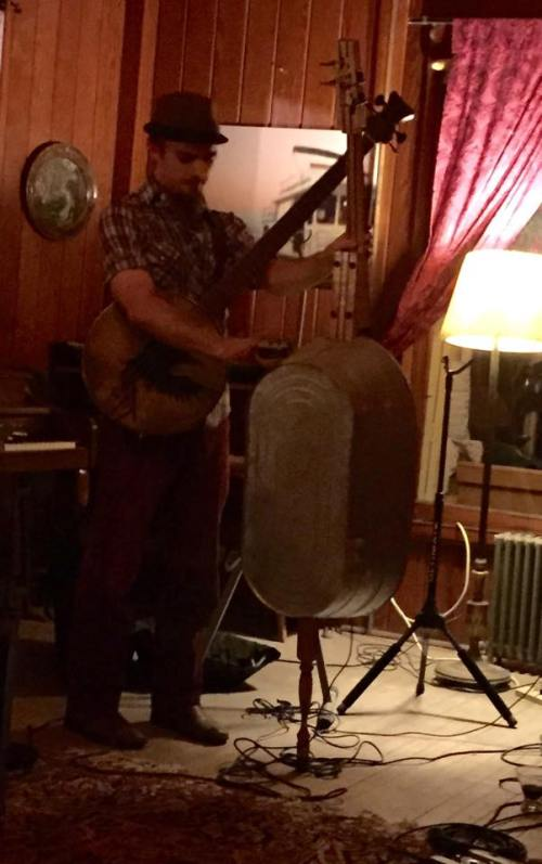 The fellow in the hat shows off his bass banjo and his actually made from a washtub standup base.