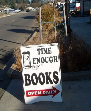 On the sign, the broken reading glasses of Henry Bemis