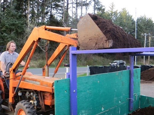Raymond dumping the mulch into our trailer...
