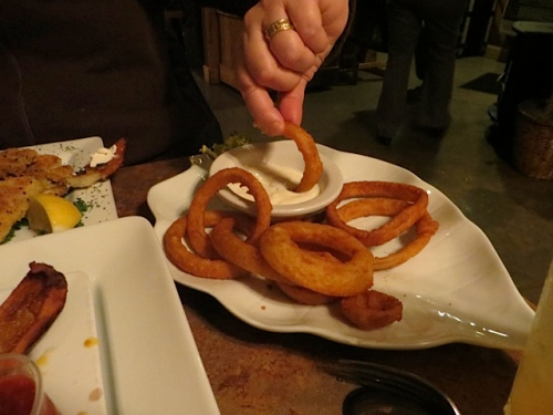 Allison dips the onion rings.