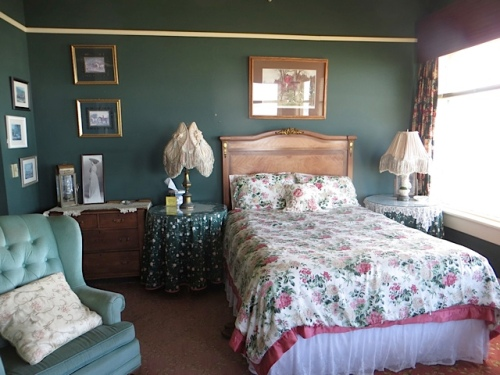 Agatha Christie's room is large with north and west windows and a fireplace.