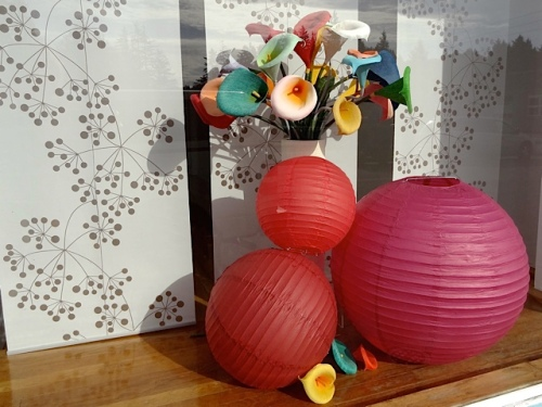 More flowers bloom in the windows of art galleries on the block.  Penny Treat Gallery