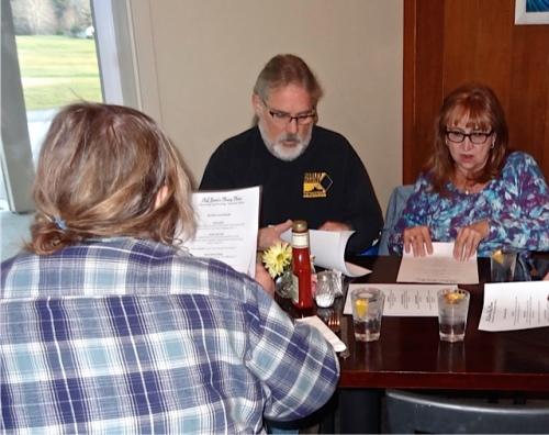 menu perusal and discussion (Allan's photo)