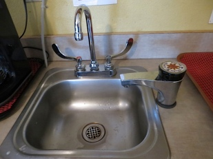 in the kitchenette....I make myself more tea.  I want a boiling water faucet like this.