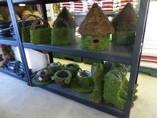 I quite like this new line of mossy birdhouses and planters.