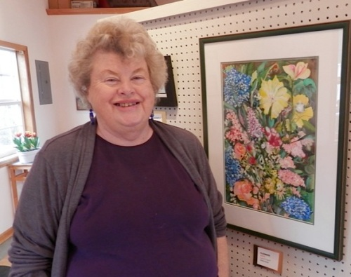 "and this glorious flower painting, here with the artist, Carol Couch.  She told me the flowers ""came out of her head""."