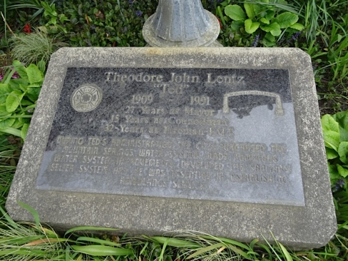The memorial marker is worn.