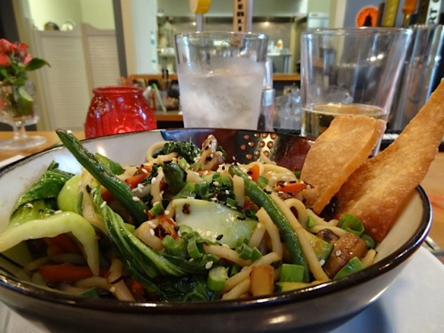 delicious vegetable stir fry bowl with udon noodles