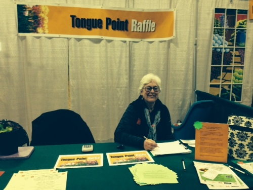 Long-time Master Gardener of Astoria, Chris Bennett works at the Tongue Point raffle table.  The Peninsula's late Bob Caswell won this raffle twice in years past.