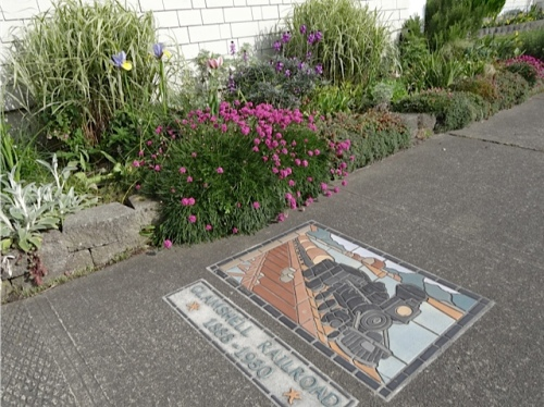 tiles by local artist Renee O'Connor are set into the sidewalk