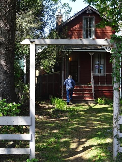 Allan entering the cottage