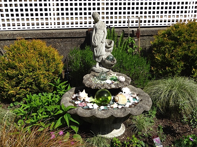 below the house deck: Mary's decorated dry fountain