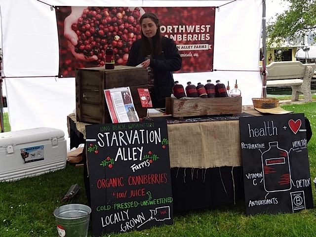 our neighbours' booth (Allan's photo); They have a staff of booth-runners at markets all over the Northwest.