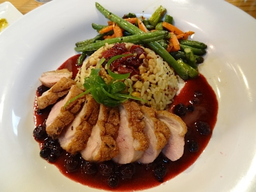 Seared duck breast with Starvation Alley Farms cranberry and wild foraged huckleberry sauce with walnut wild rice