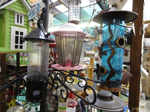 a wide assortment of bird feeders