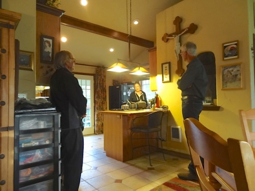 Allan, Ann, and Todd, watched over by her father's antique crucifix.