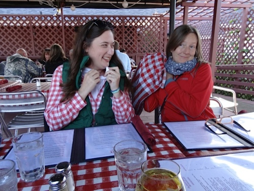 at The Depot Restaurant, Ann's shirt and Kate's bag match the deck tablecloths.