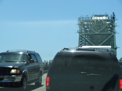 one lane traffic because of workers (shows how narrow the 4+ mile bridge is)