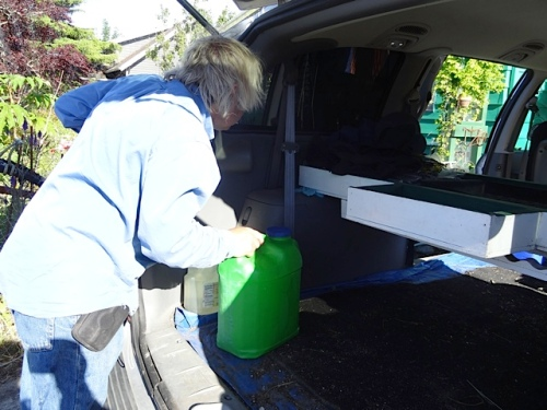 Allan loading some water jugs, also for burbling.  (I thought of it after we had dumped all our water out.)