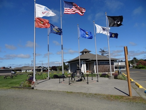 Veterans Field, where the flag poles clanked in the wind and I weeded the little garden.