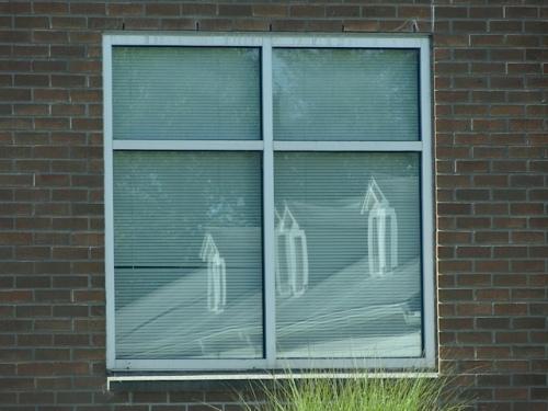 community building reflected in next door hospital window