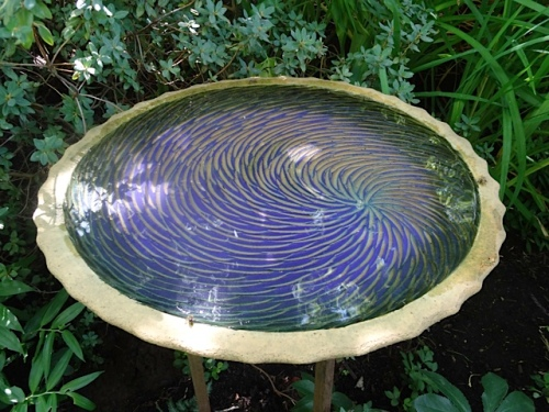 Bees came from the hives, beyond the meadow, to drink from this birdbath.
