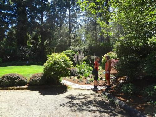 tour guests in the front garden; to their right is the newly created meditation alcove.