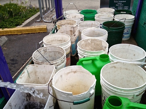 Allan's photo: filling buckets at the community building. (The boatyard water was turned off.)