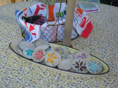 on the patio table:  Marla's grandchildren had painted these sand dollars (photo by Kathleen Shaw)